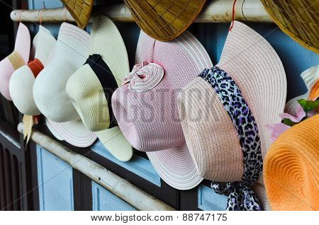 Vintage hats show on the wooden wall