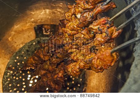 Chicken Kebabs Cooking In A Tandoori Oven