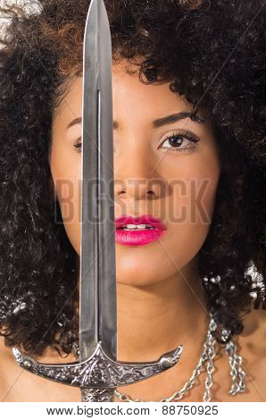 beautiful exotic young latin woman holding a dagger