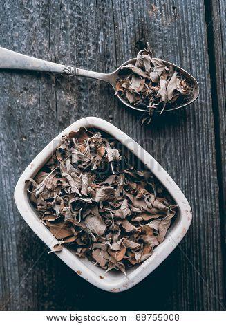 Dried Oregano On Wood Background