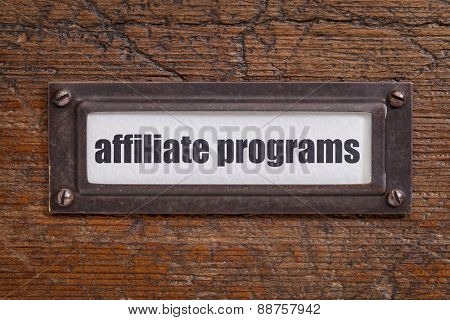 affiliate programs l  - file cabinet label, bronze holder against grunge and scratched wood
