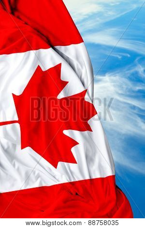 Canadian waving flag on beautiful day