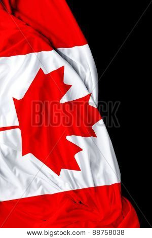 Canadian waving flag on black background