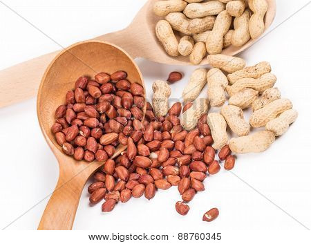 Wooden spoons with peanuts.