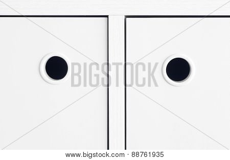 White handle cabinet