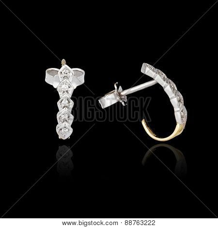 Diamond Earrings Isolated On The Black Background