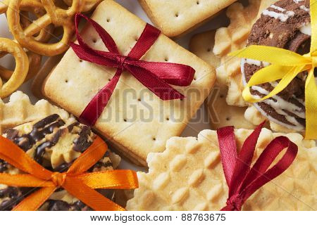 Stack of delicious cookies on napkin tied with ribbon