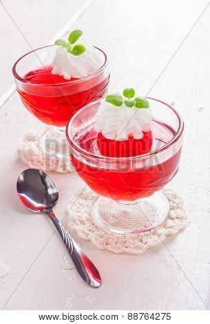Red Jelly With Whipped Cream In A Glass Bowl