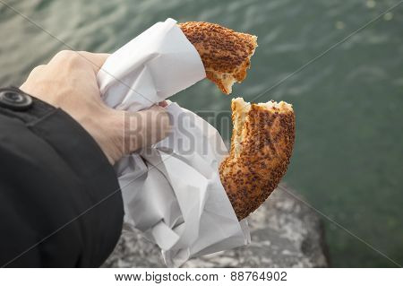 Turkish Circular Bread With Sesame Seeds In Male Hand