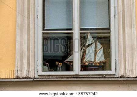 ship model in a window icon for hobby, marine, wanderlust,