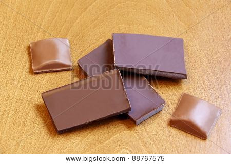 Group Of Chocolate Pieces On Wooden Background. Selective Focus