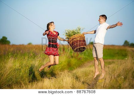 Happy Couple Having Fun Outdoors In Summer Meadow