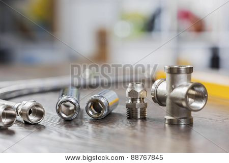 All kinds of plumbing and tools on table