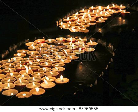 Lit Candles At Mass In Church