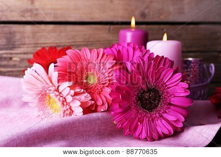 Still life with beautiful bright gerbera flowers on wooden background