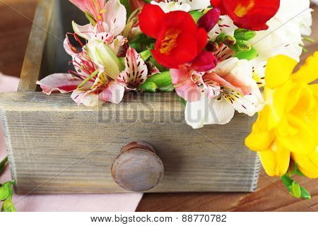Beautiful spring flowers on wooden table, closeup