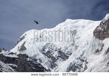 Rescue Helicopter In Himalaya Mountains, View From Annapurna Base Camp