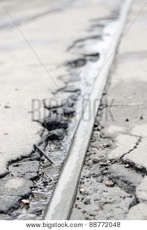 Broken asphalt road close up