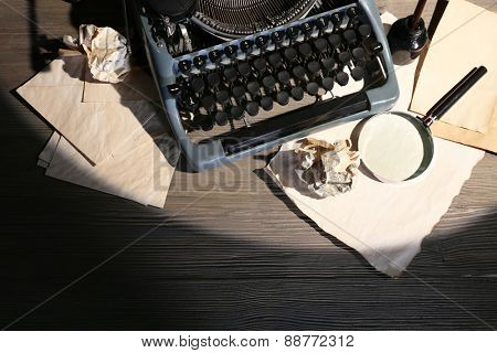 Retro typewriter on wooden background