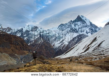 Man Taking Photos Of Machhapuchchhre (fish Tale) From Annapurna Base Camp Himalaya Mountains In Nepa