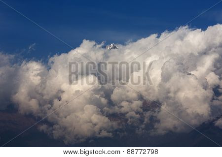 White Clouds Over Machhapuchchhre Mountain - Fish Tail In English Is A Mountain In The Annapurna Him