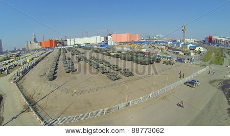 MOSCOW, RUSSIA - APRIL 20, 2014: Tanks and military equipment at Khodynskoe Field prepared for the parade of victory and construction site of shopping center Aviapark, aerial view