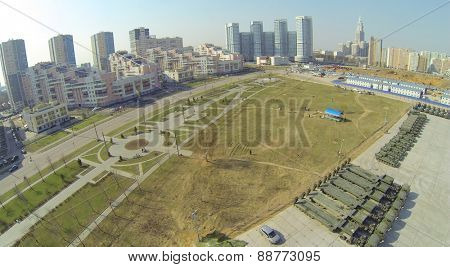 MOSCOW, RUSSIA - APR 19, 2014: Retro sport car passes by race track turn during Rally Masters Show at sunny spring day, aerial view
