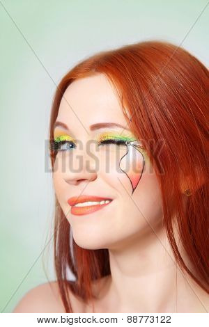 Beautiful Red-haired Girl With Bright Makeup