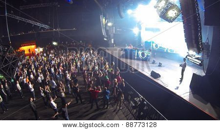 MOSCOW, RUSSIA - APRIL 5, 2014: People at the scene at the trance festival TRANSMISSION in a nightclub Stadium Live, aerial view. This festival is held for more than 10 years