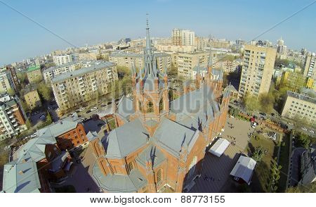 MOSCOW, RUSSIA - APRIL 20, 2014: Catholic cathedral of Immaculate Conception of Blessed Virgin Mary against cityscape at sunny day, aerial view. Cathedral was opened in 1911