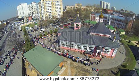 MOSCOW, RUSSIA - APRIL 19, 2014: People at the Transfiguration Church in Bogorodskoe, aerial view. It is the only surviving wooden church of the XIX century in Moscow