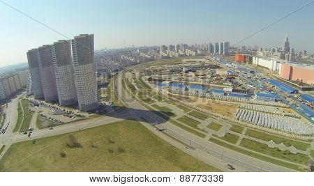 MOSCOW, RUSSIA - APRIL 20, 2014: Cityscape with dwelling buildings around Hodynskoe field at spring sunny day, aerial view