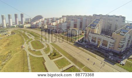 MOSCOW, RUSSIA - APRIL 20, 2014: Hodynskoe field with alley of Pilots heroes and residential complex Parus, aerial view