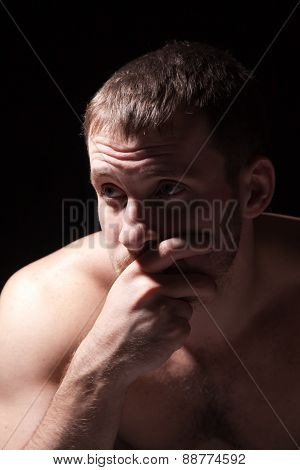 Image Of Shirtless Man Keeping His Hand By Face