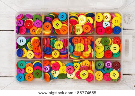 Box of olorful sewing buttons