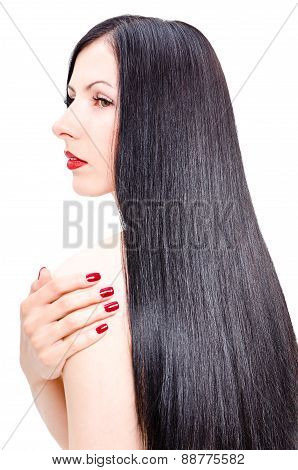 Portrait of a beautiful young woman with groomed long straight hair