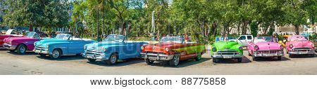 HAVANA,APRIL 3,2015 : Group of colorful vintage cars parked in Old Havana