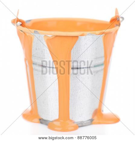 Bucket of orange paint isolated on white