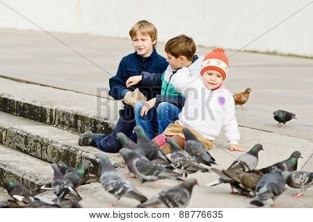 Children Feeding Doves