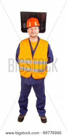 Worker in hard hat holding shovel