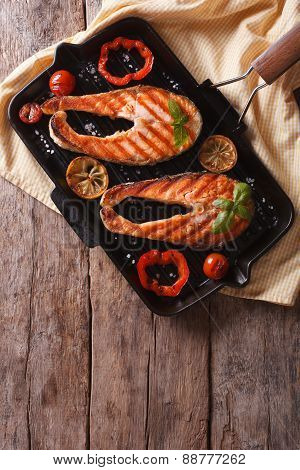 Salmon Steaks And Vegetables On The Grill Pan. Vertical Top View