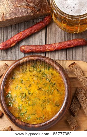 Dutch beer yellow soup with sausage croutons parsley herb and be