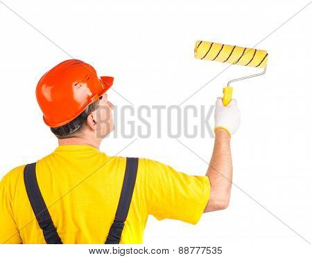 Worker in hard hat with roller