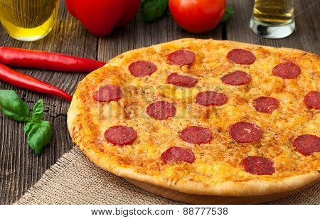 Pizza pepperoni unsliced traditional food on vintage background