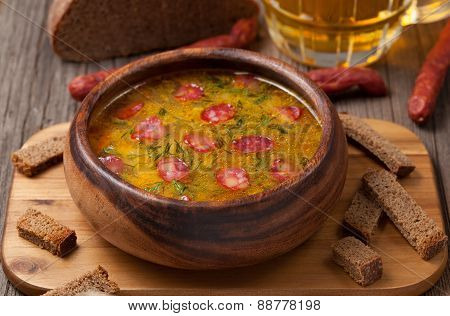 Traditional beer soup with cheese sausage dill croutons and bread