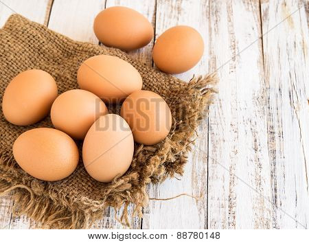 Chicken Brown Eggs On Wooden Background
