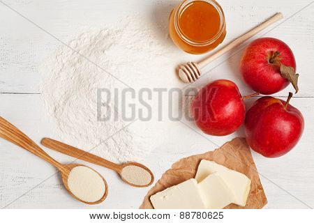 Preparation of pie Flour, butter, honey and yeast on white table