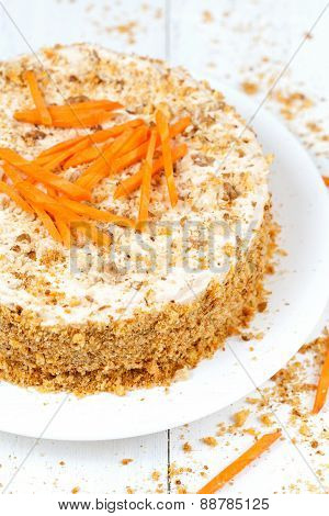 Delicious sponge cake with walnut crumbs and carrot slices on top
