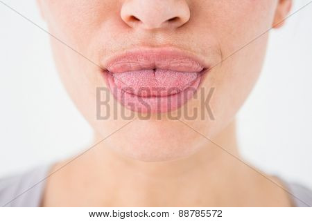 Woman with luscious lips on white background