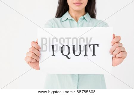 Brunette holding i quit card on white background